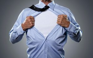 Young businessman tearing his shirt off isolated on gray background with copy space