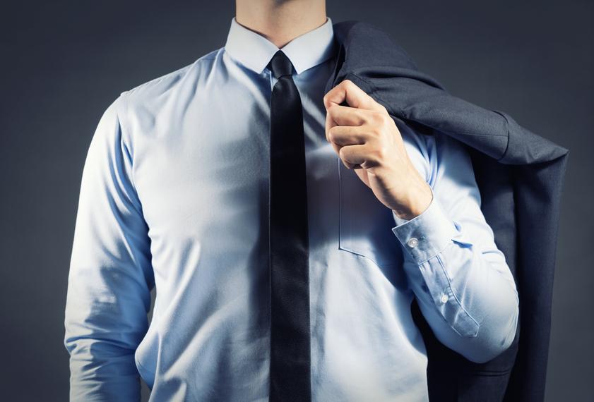 Businessman holding his suit
