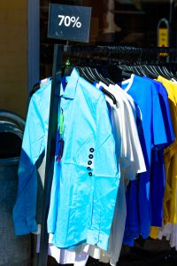 Simrishamn, Sweden - April 1, 2016: Shirts on an outdoor rack selling at 70 percent off.